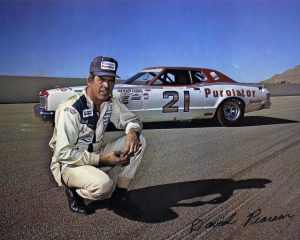 Driver David Pearson poses next to his famous #21 Wood Brothers Mercury at Riverside Raceway  circa 1972