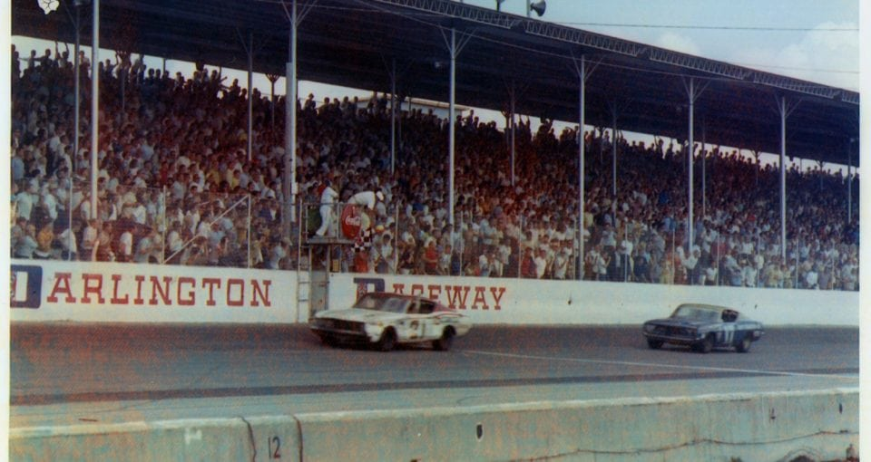 The #21 Wood Brothers Mercury driven by Cale Yarborough takes the checkered flag followed closely by #17 David Pearson to win the 1968 Southern 500
