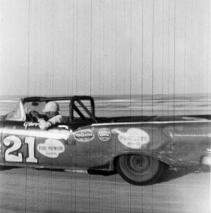 Glen Wood in his #21 NASCAR Convertible Series car on the sands of the Daytona Beach course in 1957